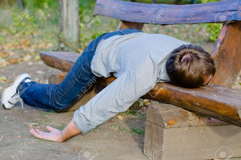16440996-Drunk-man-sleeping-in-park-on-wooden-bench-Stock-Photo